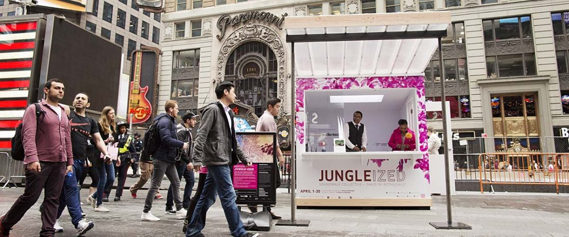 JUNGLE-IZED: A Conversation with Nature April 1, 2016 - April 30, 2016 Soundwalk Collective Photograph by Ka-Man Tse for @TSqArts. Soundwalk Collective and Times Square Arts will present JUNGLE-IZED, a month-long interactive multi-sensory art installation that will transform Times Square, transporting close to a half a million visitors daily to the heart of the Amazon. Presented in collaboration with David de Rothschild, and in partnership with The Times Square Advertising Coalition (TSAC), Times Square Arts, Audio-Technica, and CXA+ART, this immersive installation includes a participatory audio experience and an interactive video to encourage a conversation with nature and to heighten awareness of the environmental impact of climate change.